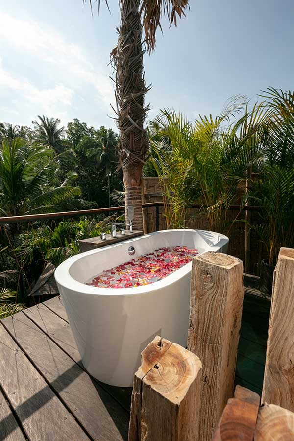 Gorgeous luxury stone bath outdoor bathroom in Ubud Bali Yoga Retreat