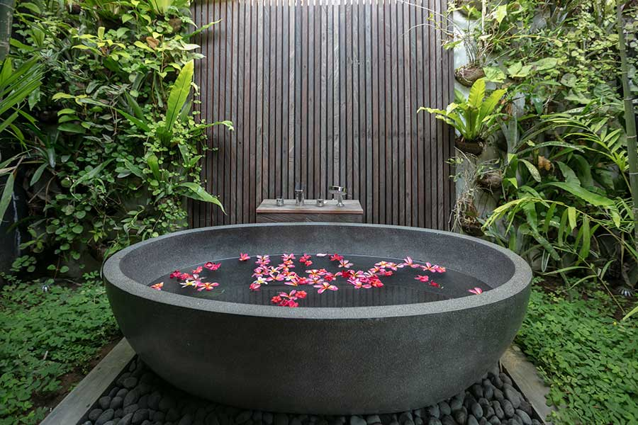 Gorgeous luxury stone bath outdoor bathroom in Bali Ubud Yoga Retreat