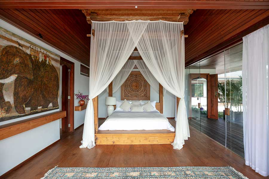 Luxury bedroom with canopy bed Ubud Bali accomodation