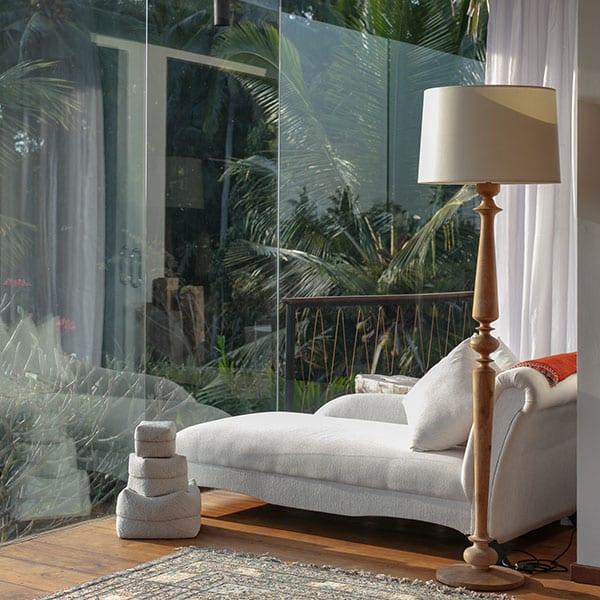 Stunning bedroom with glass walls in Ubud Sanctuary Bali Retreat