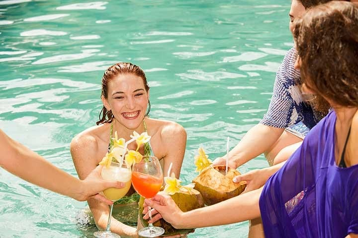 girls enjoying cocktails in the pool