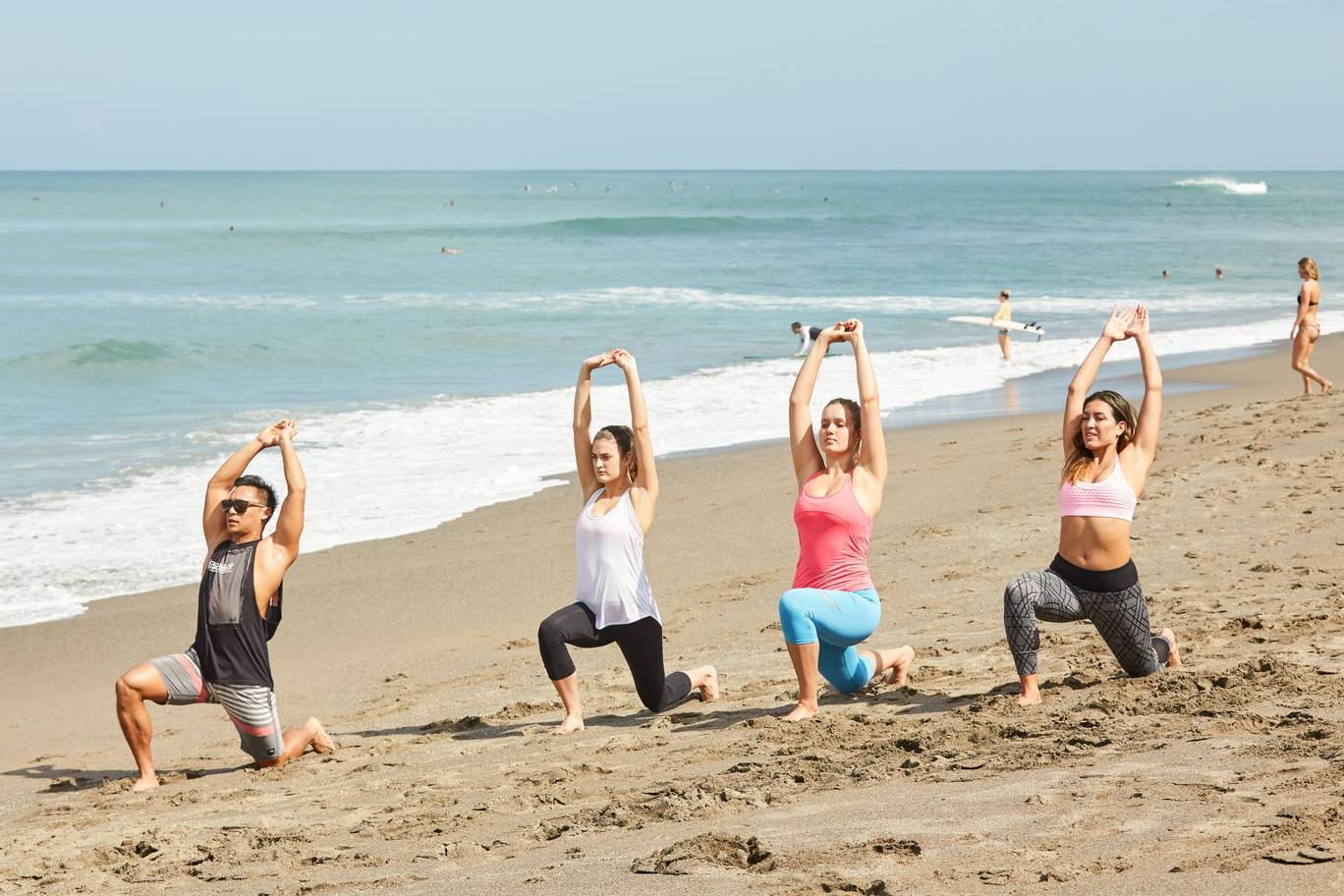 small group of women performing fitness training on a Bali beach