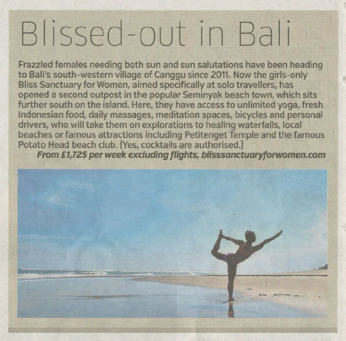 newspaper clipping - yoga posing woman on Bali beach