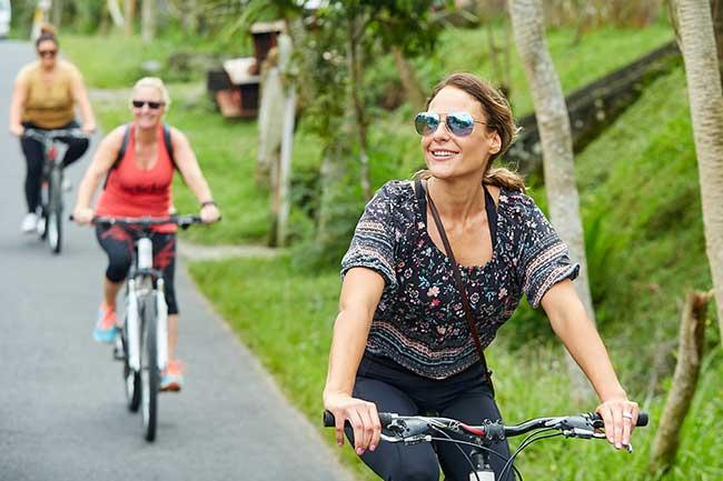 Bali wellness retreat, ladies riding bikes