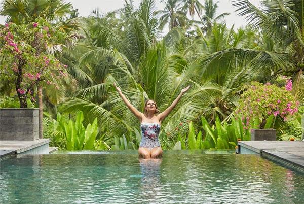 Woman relaxing in beautiful pool in Bali