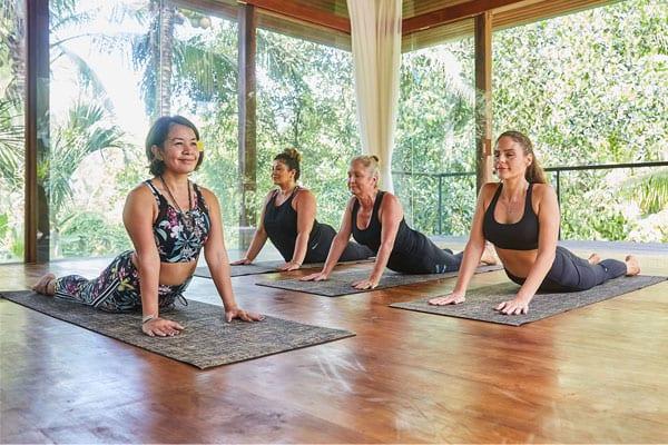 Women doing yoga at Bliss Bali retreat