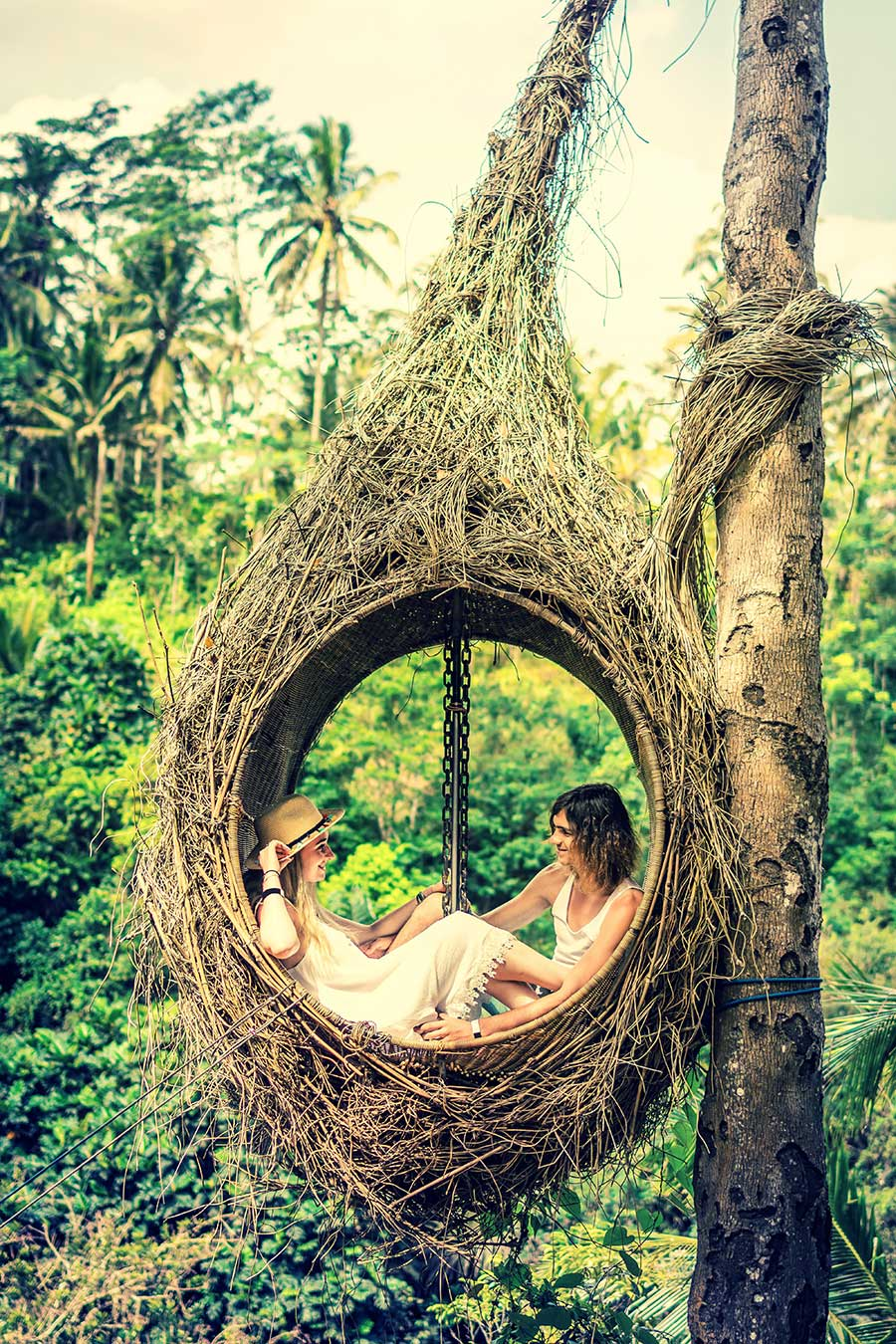 Bali couple cosy in swing