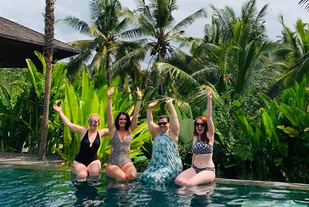 Friends laughing having fun poolside at Bliss Bali retreat