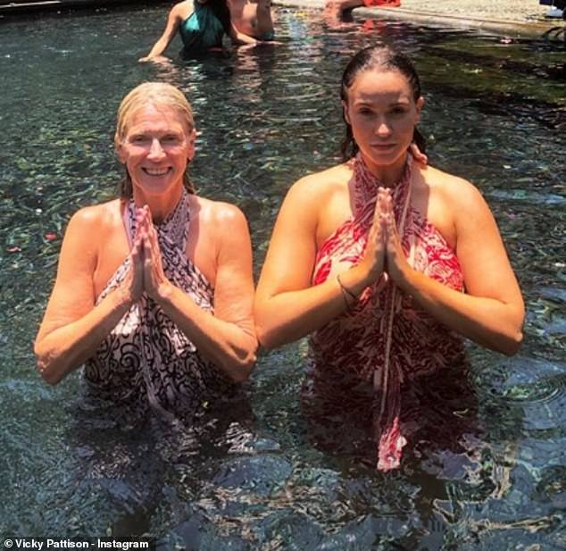 Namaste: Vicky and her mother held a prayer pose while waist-deep in the water