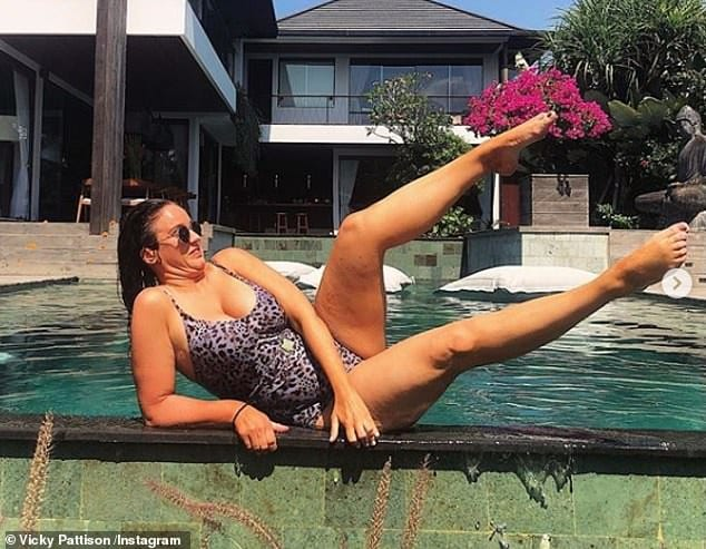 There she goes! The reality star, 31, was modelling an animal print swimsuit as she stretched out by the water's edge at her luxurious Bliss Sanctuary for Women getaway - only to tumble in mere moments later