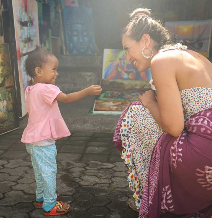 Bliss Bali retreat guest with Balinese child