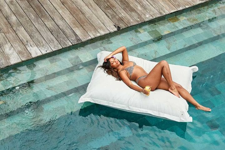 Love Island celebrity Samira Mighty relaxing on pool pillow at Bliss Bali retreat