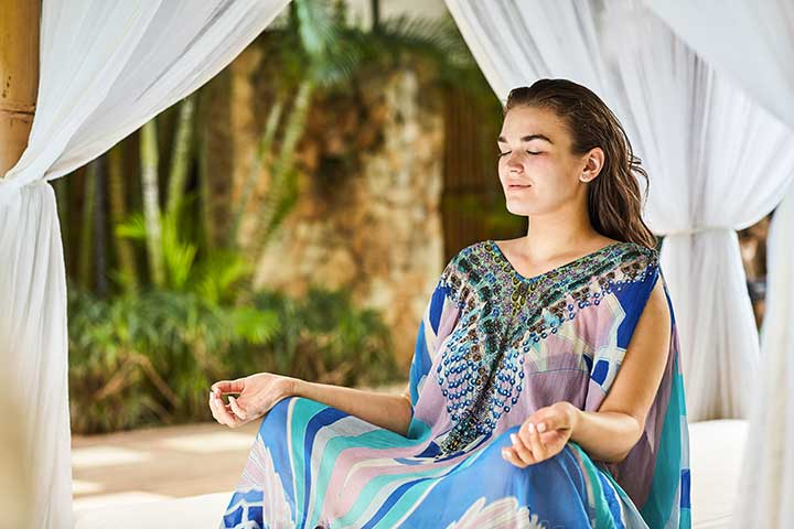 Bliss Bali retreat guest meditating in beautiful setting