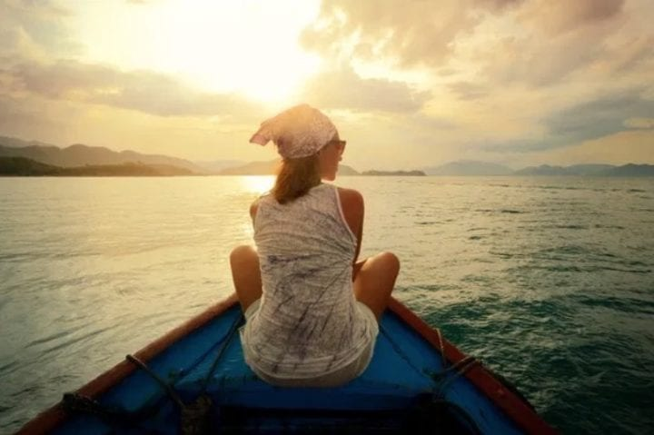 Woman on her own in boat on water