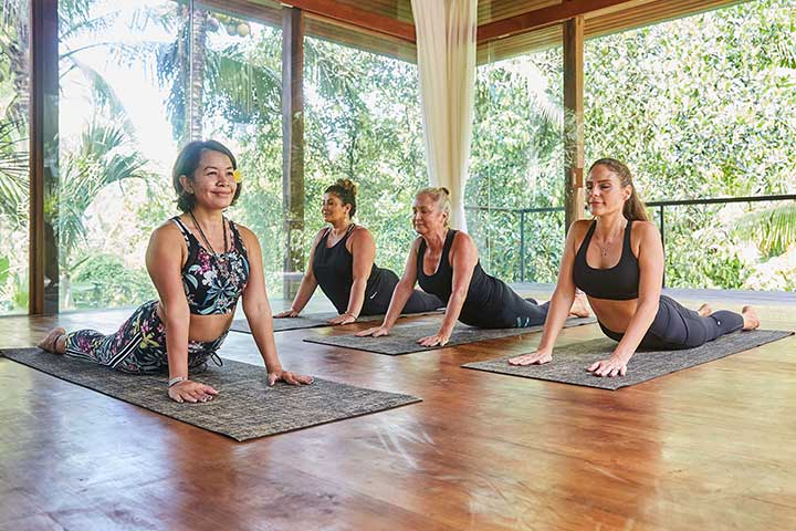 Yoga class at Bliss Sanctuary for Women, Upward-Facing Dog pose