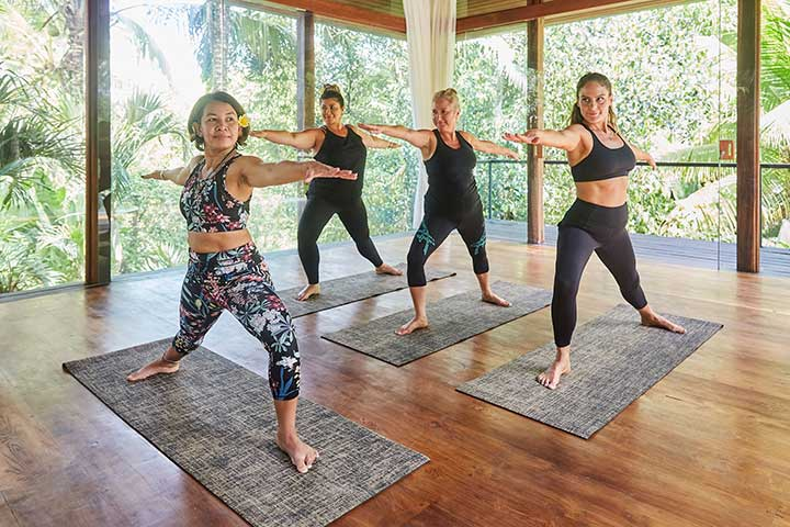 Yoga class at Bliss Sanctuary for Women, Warrior II pose