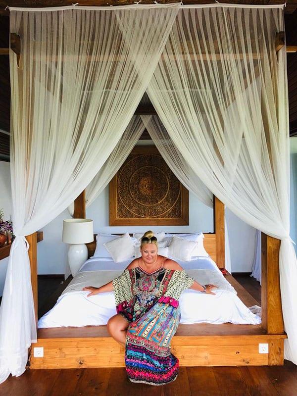 Zoe Watson Bliss Bali retreat founder relaxing on deluxe bed